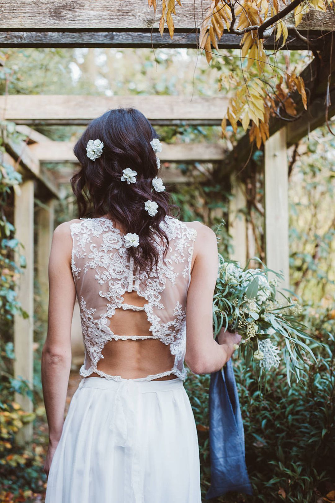 Back of Boho bride wearing delicate knitted bridal separates by Jessica Turner Designs