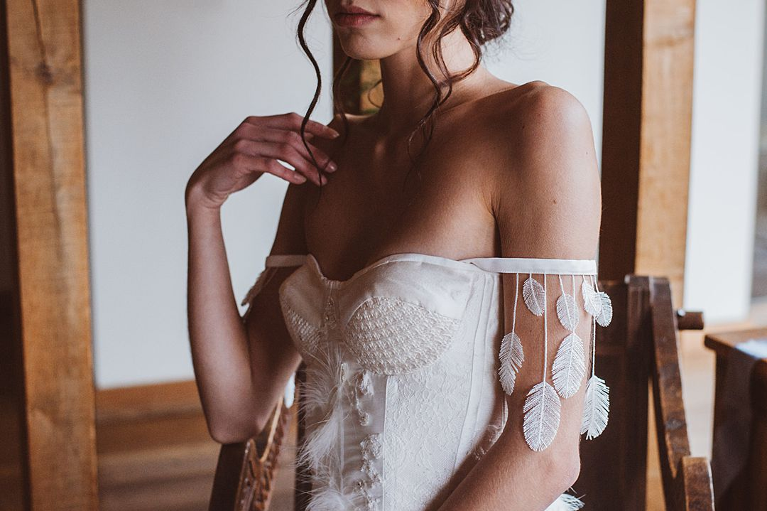 Beautiful bohemian Bridal Corset with Feathers and Knitted Details by Jessica Turner Designs