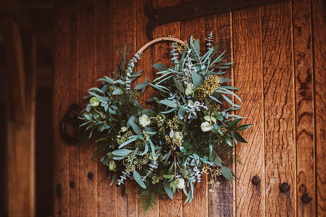 alternative wedding bouquet. Wedding wreath with white flowers and green foliage by Sarah Harper Flowers