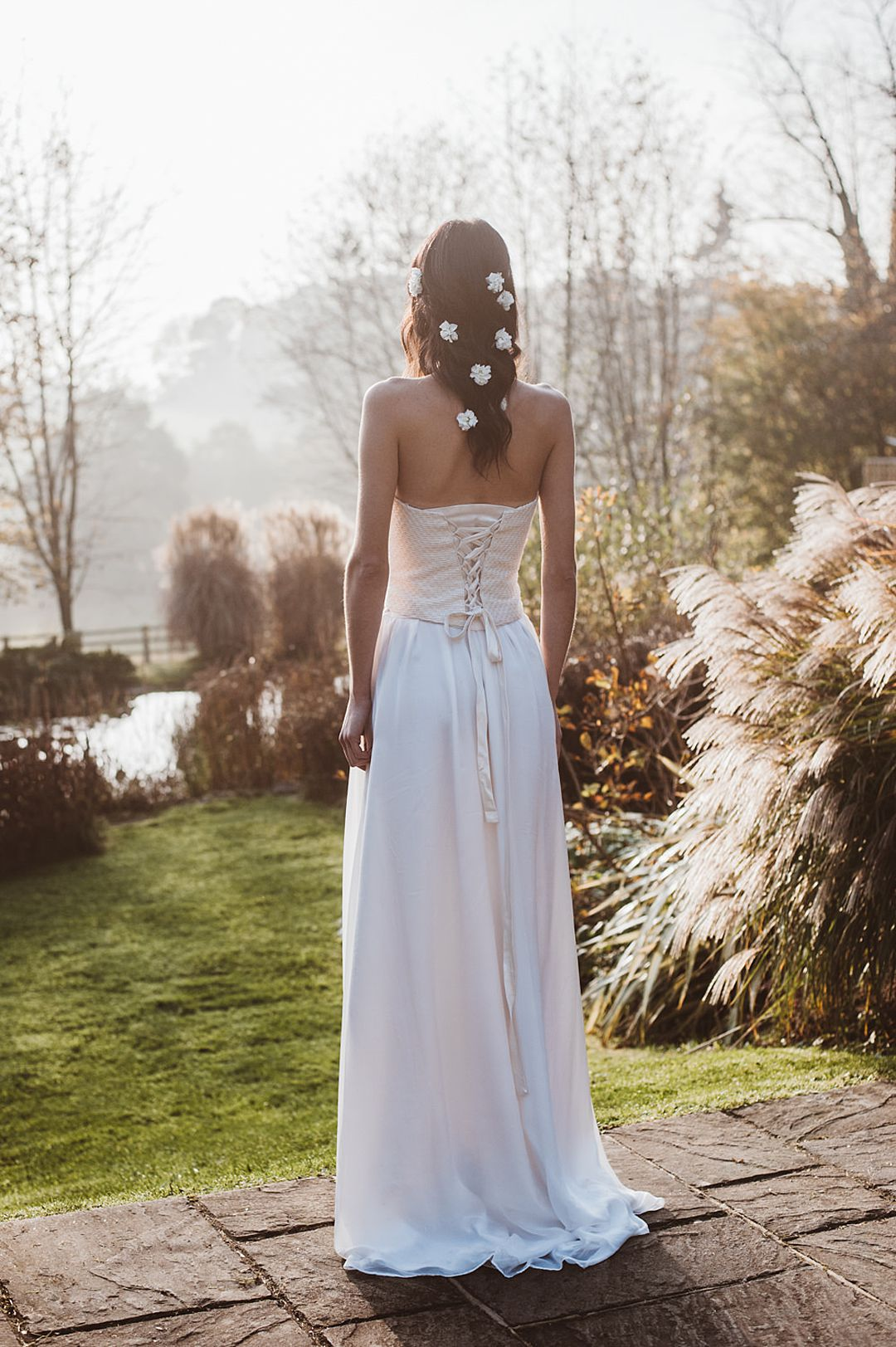boho bride with relaxed plait wearing Jessica Turner Designs Knitted Bridal Corset and Separates